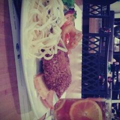 Photo taken at Tamani Kafe Grill by Fildza T. on 7/2/2012