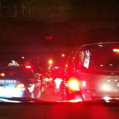 Photo taken at Perempatan Kuningan (Traffic Light) by Indira S. on 8/16/2012