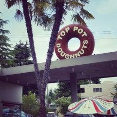 Photo taken at Top Pot Doughnuts by Cheryl on 6/14/2014