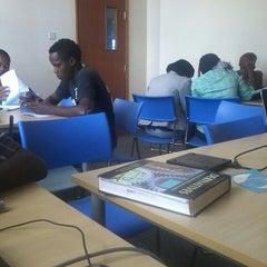 Photo taken at Kenyatta University Post Modern Library by Derrickshire M. on 4/3/2014