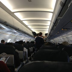 Photo taken at Gate A25 by Will S. on 12/24/2012