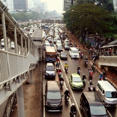 Photo taken at Jalan Jenderal Gatot Subroto by Ade U. on 7/23/2013