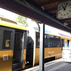 Photo taken at Bahnhof Gstaad by YC Y. on 9/7/2014