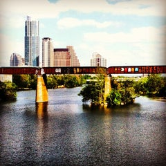 Photo taken at Barton Springs Pedestrian Bridge by Freedom R. on 4/8/2013