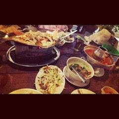 Photo taken at Khunthai Authentic Thai Restaurant by Anna L. on 3/13/2013