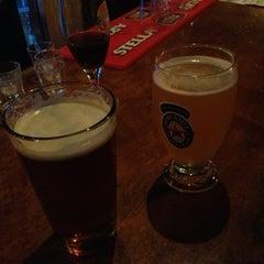 Photo taken at Growler's Pub by Meg L. on 9/4/2013