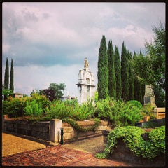 Photo taken at Oakland Cemetery by Traci S. on 6/11/2013