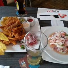 Photo taken at Revolution Cevicheria y cocina peruana by Omar V. on 4/13/2014