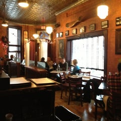 Photo taken at Cafe Saint-Ex by Kevin K. on 12/26/2012