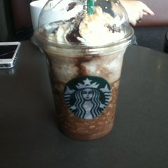 Photo taken at Starbucks by Lara S. on 8/10/2014