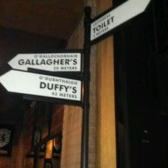 Photo taken at Trinity Three Irish Pubs by Karen E. on 1/4/2012
