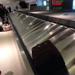 Photo taken at Baggage Claim by Eric Carter H. on 4/26/2014