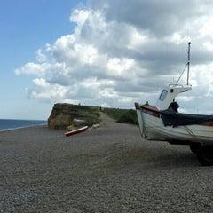 Photo taken at Weybourne Beach by Puteri N. on 5/28/2015