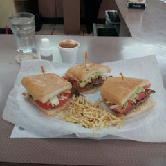 Photo taken at El Tropico Cafe by Joseph F. on 9/19/2013