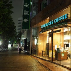 Photo taken at Starbucks Coffee 茅場町店 by Akihito on 7/18/2013