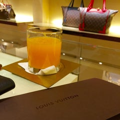 Photo taken at Louis Vuitton by Brian V. on 7/19/2015