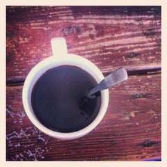 Photo taken at Epoch Coffee by ANNA S. on 6/10/2013
