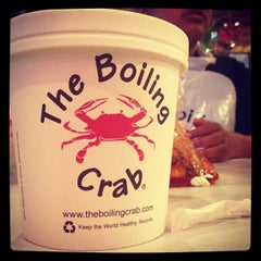 Photo taken at The Boiling Crab by Miguel R. on 10/18/2012
