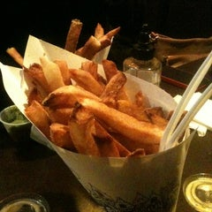 Photo taken at Pommes Frites by Marquita F. on 11/3/2012