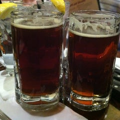 Photo taken at Hops Grill and Brewery by Samantha D. on 3/6/2013