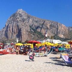 Photo taken at Spiaggia San Vito Lo Capo by Yakup C. on 7/15/2013