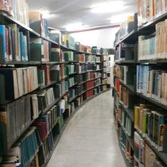 Photo taken at Biblioteca PUC Minas by Rafaela B. on 2/28/2014
