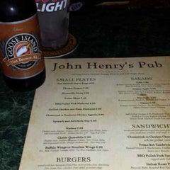 Photo taken at John Henry's Pub by Ian S. on 7/25/2013