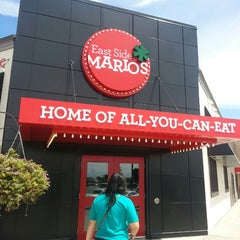 Photo taken at East Side Mario's by Courtney T. on 7/26/2013