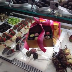 Photo taken at Godiva Chocolatier by Chloe K. on 8/6/2014