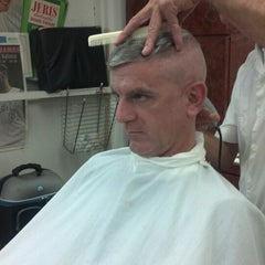 Photo taken at Carl's Barber Shop by Joey S. on 9/24/2013