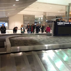 Photo taken at Baggage Claim by Eric M. on 12/1/2012