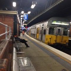 Photo taken at Strathfield Station (Platforms 7 & 8) by Freddlesticks on 9/22/2014