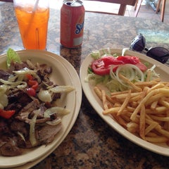 Photo taken at Tropical Beach Cafe by Mike A. on 3/16/2015