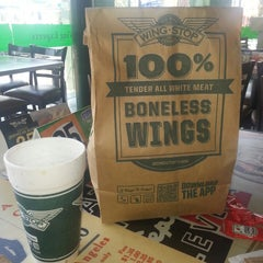 Photo taken at Wingstop by Fabiola V. on 7/1/2013