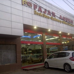 Photo taken at Fajar Agung Book Store by Citra F. on 10/10/2012