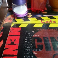 Photo taken at Cafe Cine by Birvan K. on 6/24/2013