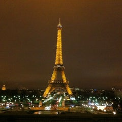 Photo taken at Tour Eiffel by Duygu S. on 7/22/2013