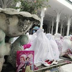 Photo taken at Masjid Agung Al-Falah by Kamila D. on 8/8/2013