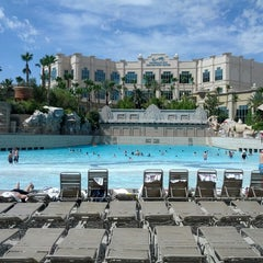 Photo taken at Mandalay Bay Beach by Alex M. on 6/12/2013