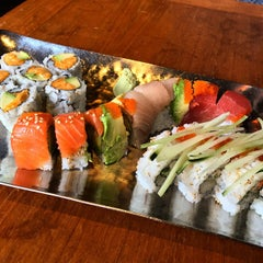 Photo taken at Coast Sushi Bar by Leah J. on 3/1/2015