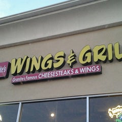 Photo taken at Granite's Famous Cheesesteaks & Wings by Kristen J. on 7/28/2014