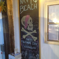 Photo taken at Navy Beach Restaurant by Janet C. on 5/27/2013