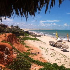Photo taken at Praia de Canoa Quebrada by Roberto R. on 3/5/2012