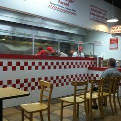 Photo taken at Five Guys by Benjamin B. on 3/11/2012
