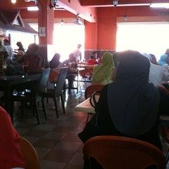 Photo taken at Nasi Dagang Ulik Mayang by Danny M. on 1/9/2011