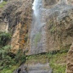 Photo taken at Curug Muncar by Angga S. on 10/16/2011