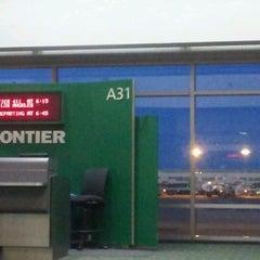 Photo taken at Gate A31 by Tony K. on 1/1/2012