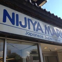 Photo taken at Nijiya Market by Linda K. on 7/18/2012