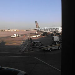 Photo taken at Gate A30 by charl p. on 6/23/2012
