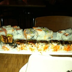 Photo taken at Blue Moon Asian Grill & Sushi Bar by Jacquelyn on 7/7/2012
